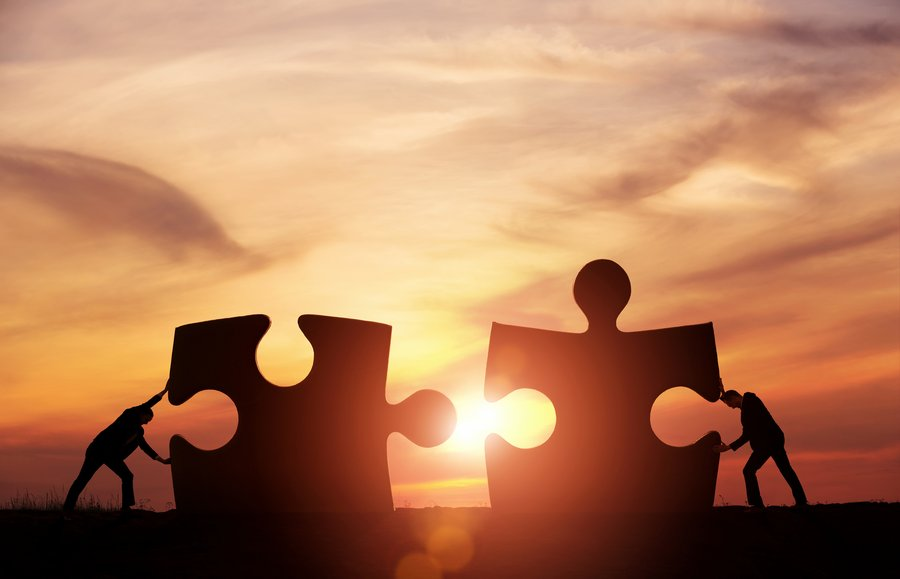 Jigsaw teamwork partnership work together collaborate